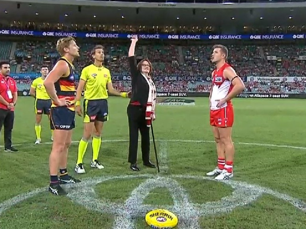Plane crash survivor Cynthia Banham tossed the coin for the Swans and Crows match