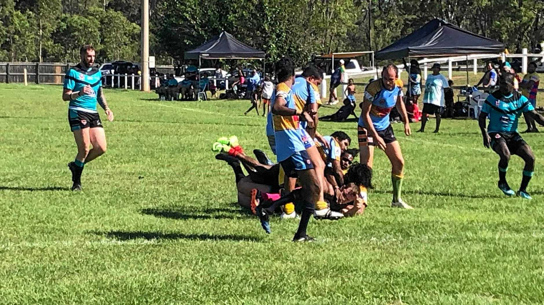 TRY TIME: Biloela Panthers crashing over the try line.