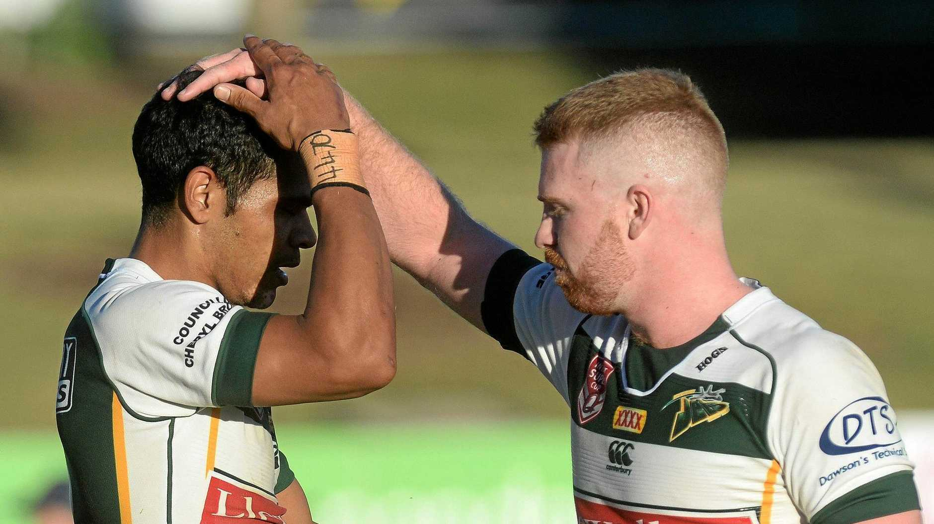 Ipswich Jet and Brothers recruit Chris Ash (right) congratulates Michael Purcell during an Intrust Super Cup match.