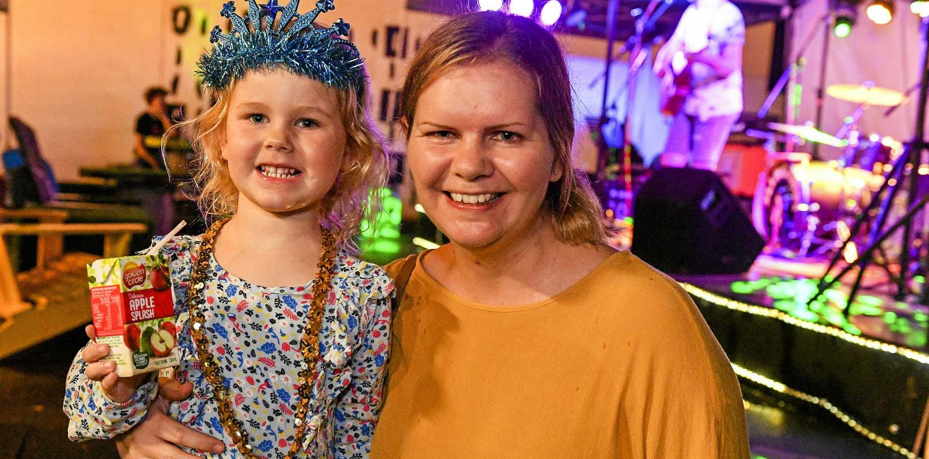 Tegan Pittard with Cadence, 4 were loving the live entertainment on their Saturday night.