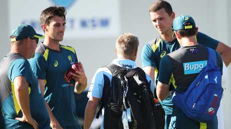 David Warner talks with quicks Pat Cummins and Josh Hazlewood after having a hit in the nets. Picture. Phil Hillyard