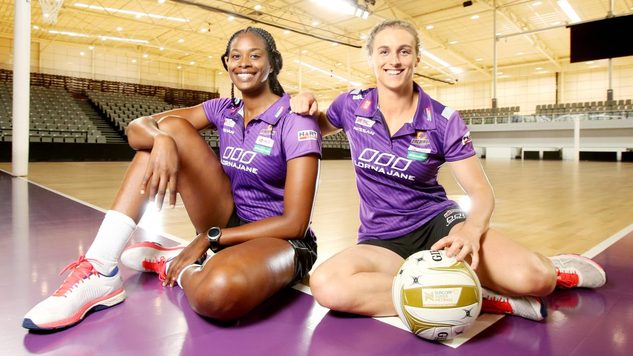 Firebirds Romelda Aiken and Gabi Simpson. Picture: AAP