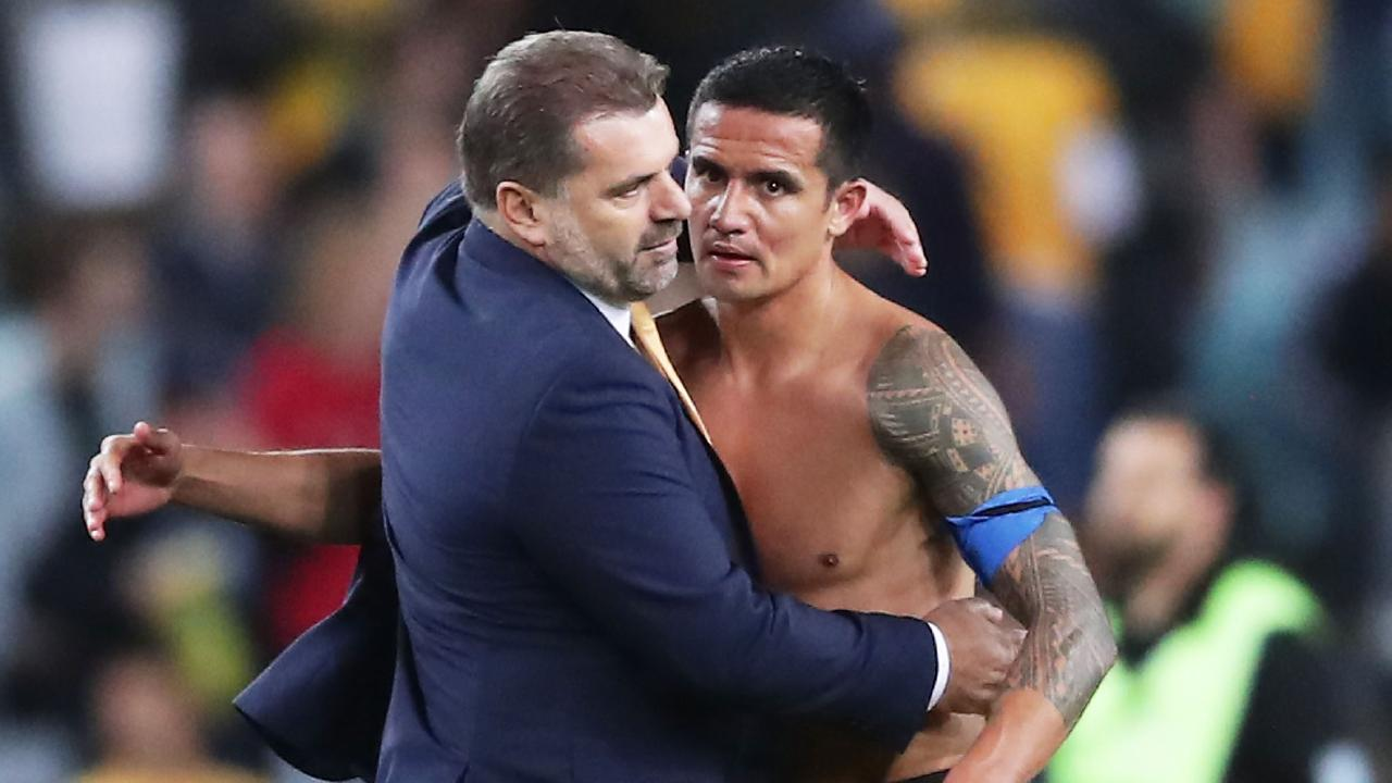 Postecoglou embraces Tim Cahill after the Socceroos sealed their spot at the World Cup. Picture: Getty