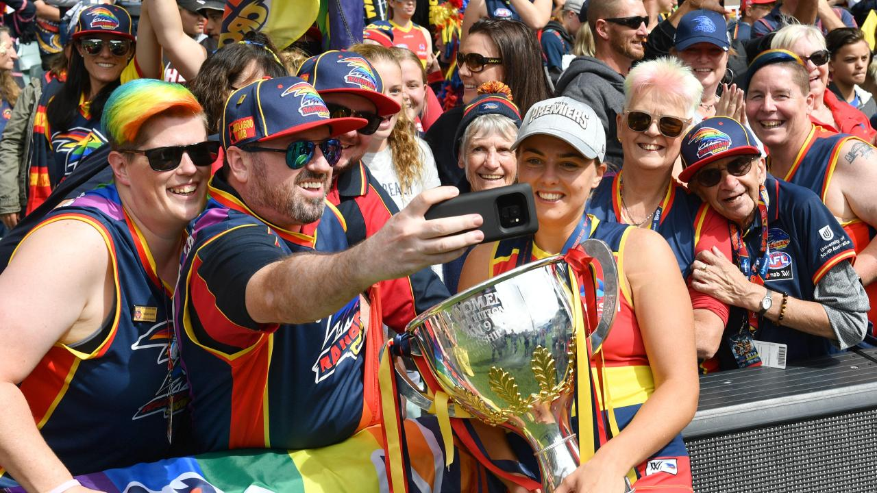 The crowd gathers with Ebony Marinoff to celebrate Adelaide's grand final triumph. Picture: AAP/ Keryn Stevens.