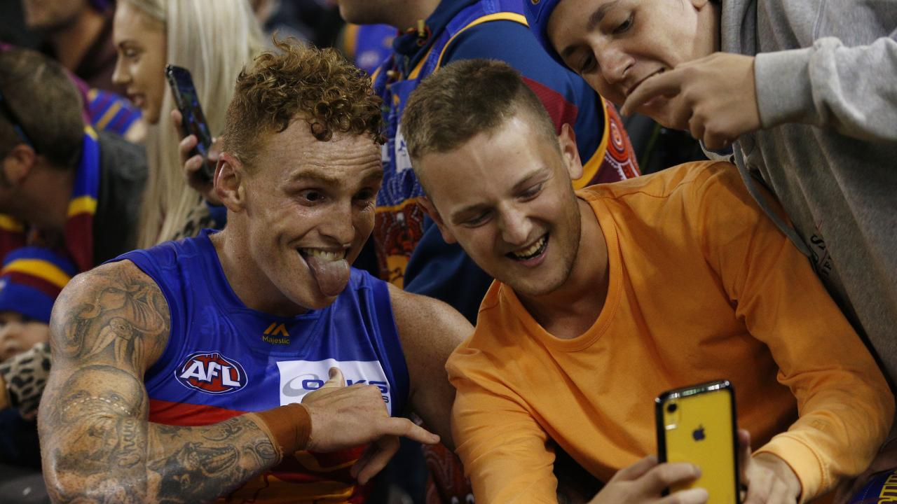 Lions hard man Mitch Robinson gets a selfie with fans. Picture: AAP