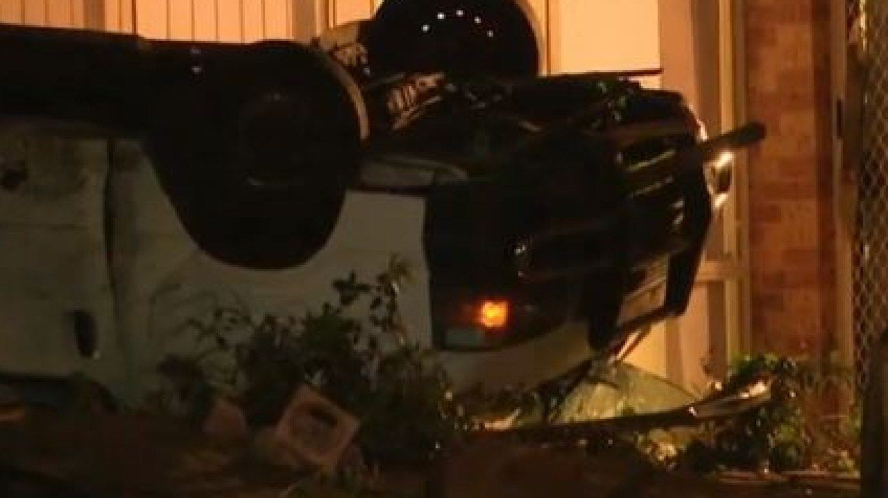 A teenager is in a critical condition after rolling a stolen van into a backyard in Sydney's south west. Photo: Nine