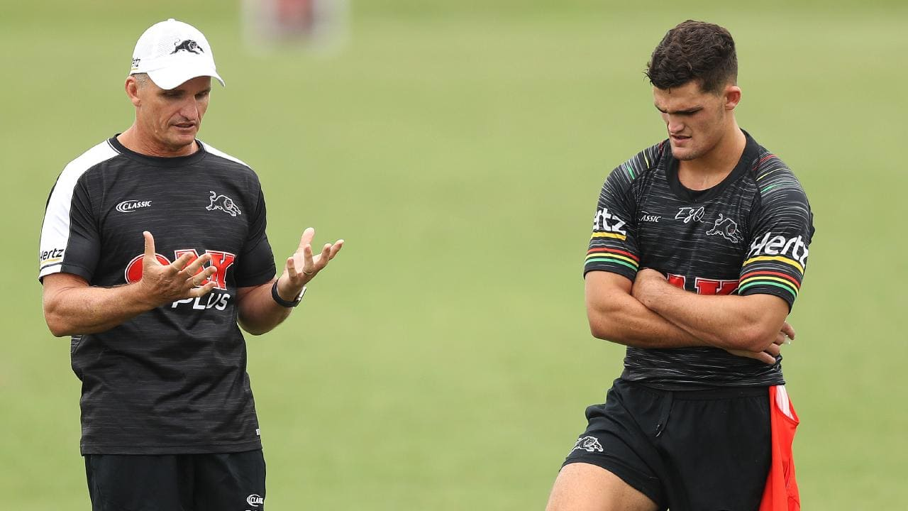 Coach Ivan Cleary speaks to son Nathan Cleary during a Panthers training session. Picture: Brett Costello