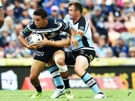 Round 3 match of the NRL Telstra Premiership between the North Queensland Cowboys v Cronulla Sharks from 1300 Smiles Stadium, Towsnville. Cowboys Te Maire Martin is tackled by Sharks Josh Morris. Picture: Zak Simmonds