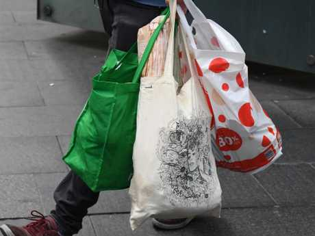 Australian retailers Coles and Woolworths banned their single-plastic bags last year, causing uproar among shoppers. Picture: AAP Image/Peter RAE