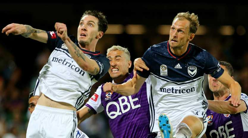 PERTH, AUSTRALIA - MARCH 30: Storm Roux of Melbourne Victory Jason Davidson of the Perth Glory and Ola Toivonen of Melbourne Victory all go up for a header during a corner kick during round 23 match between Perth Glory and Melbourne Victory at HBF Park on March 30, 2019 in Perth, Australia. (Photo by James Worsfold/Getty Images)