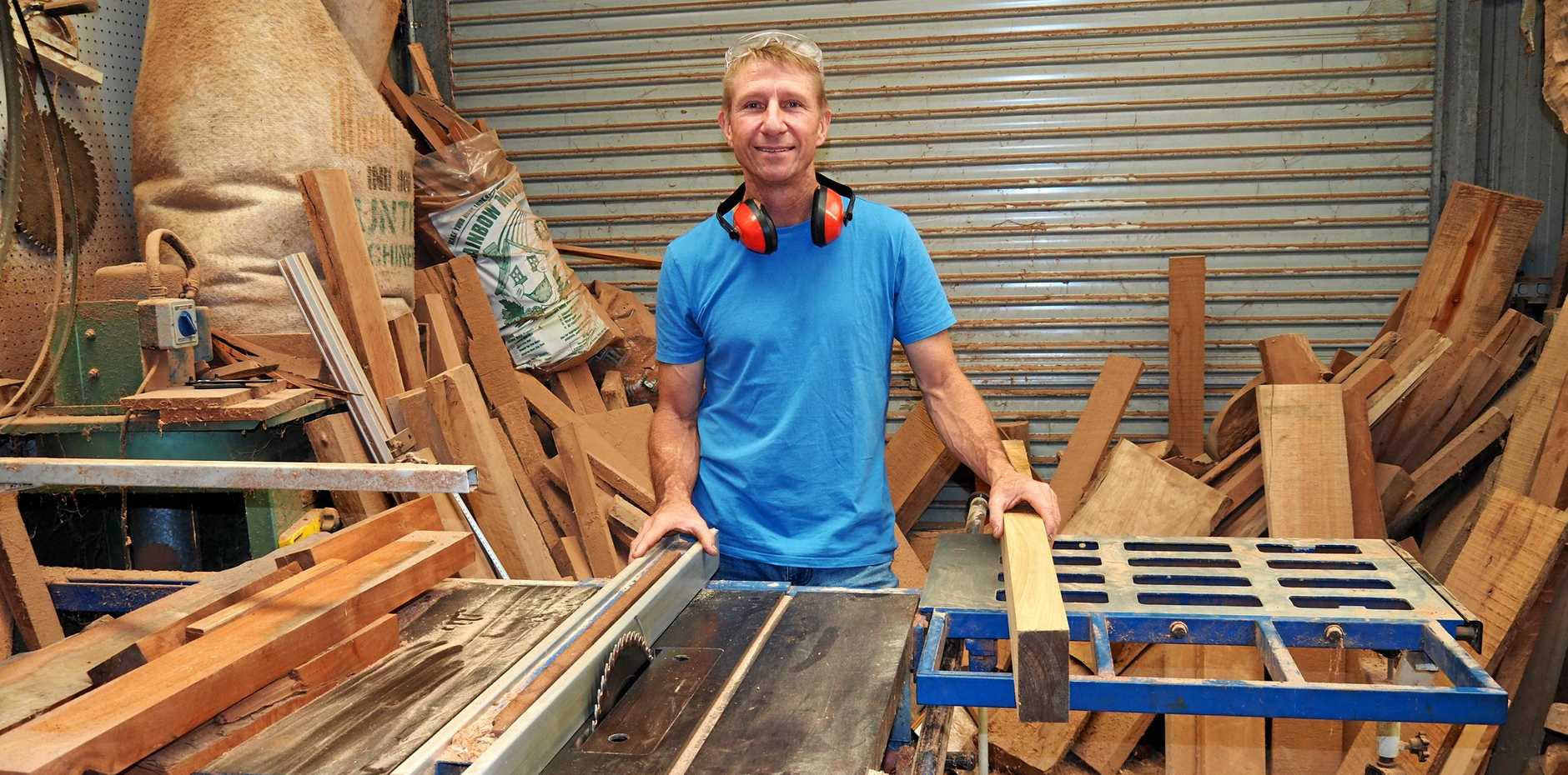 MOBILE SAWMILLER: Ken Cowden loves working with timber and his clients.