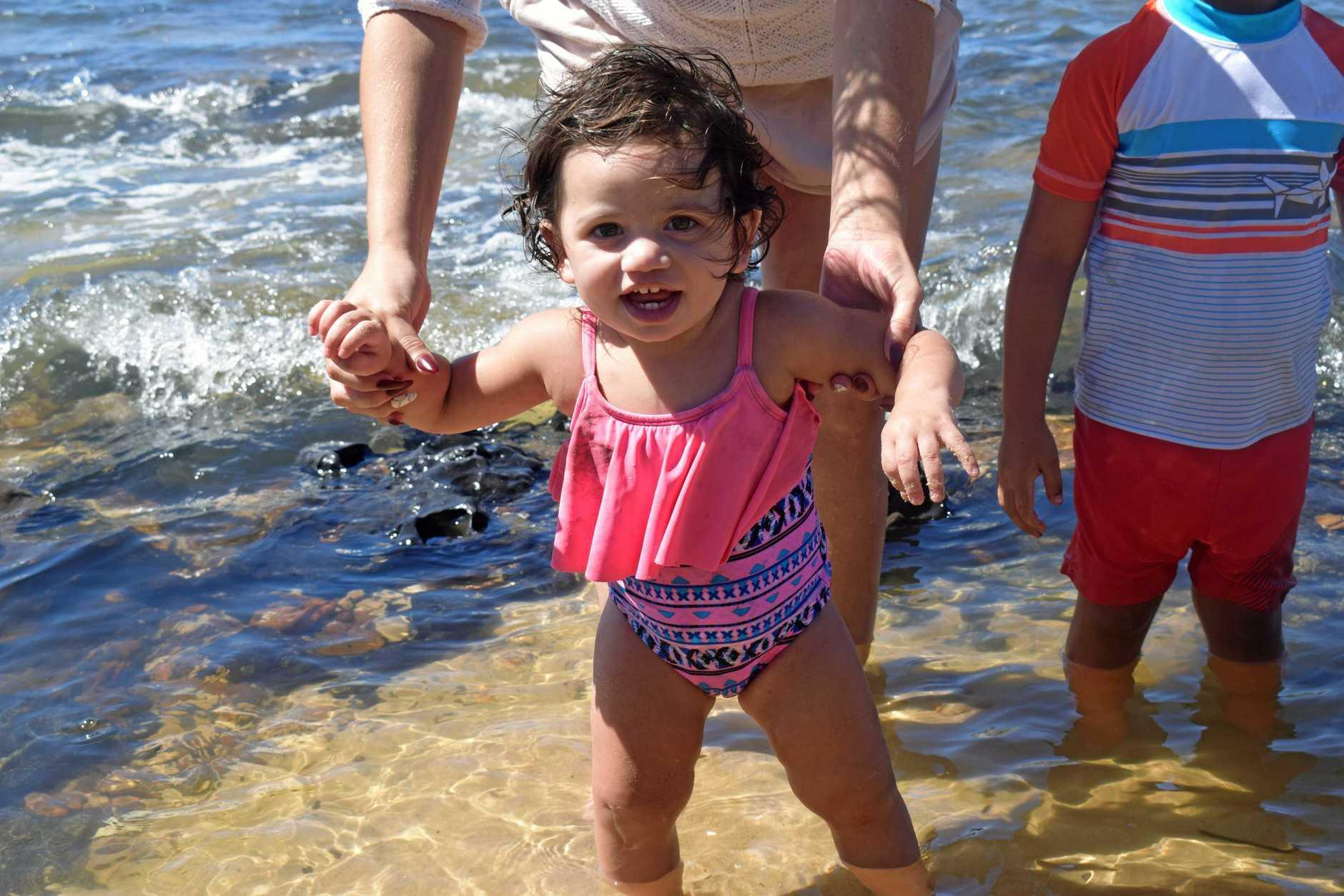 Tazanna Williams, 1, enjoys a quick dip at Mudlo Rocks on Sunday afternoon.