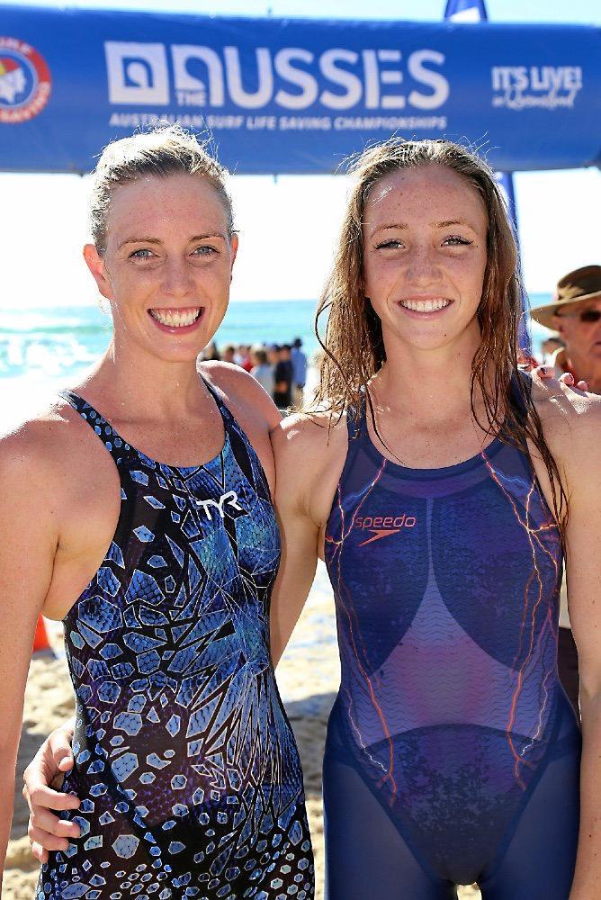 Alexandria Headland athlete Lani Pallister (right) defeated Noosa's Kareena Lee in the 2km Ocean swim at the Australian Surf Life Saving Championships on Sunday.