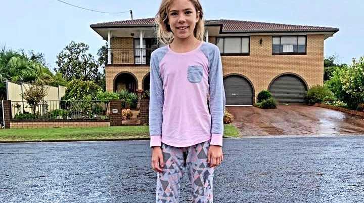 Macy Zanatta enjoying the early morning rain on Saturday. Photo shared by Heather Mengel.