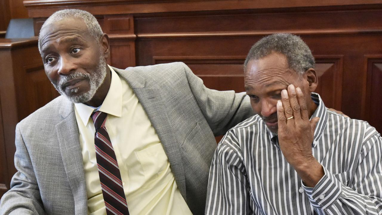 Nathan Myers, left, embraces his uncle, Clifford Williams, after their 1976 murder convictions were overturned in Jacksonville, Florida. Picture: AP