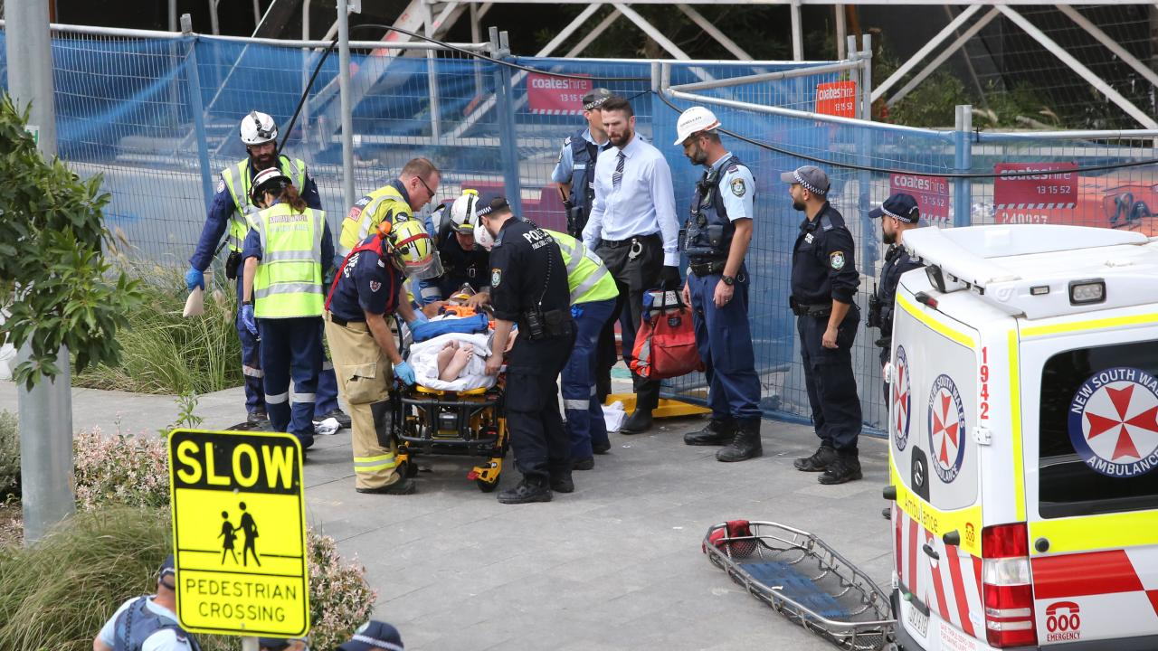 One worker remains trapped under the scaffolding. Picture: Richard Dobson