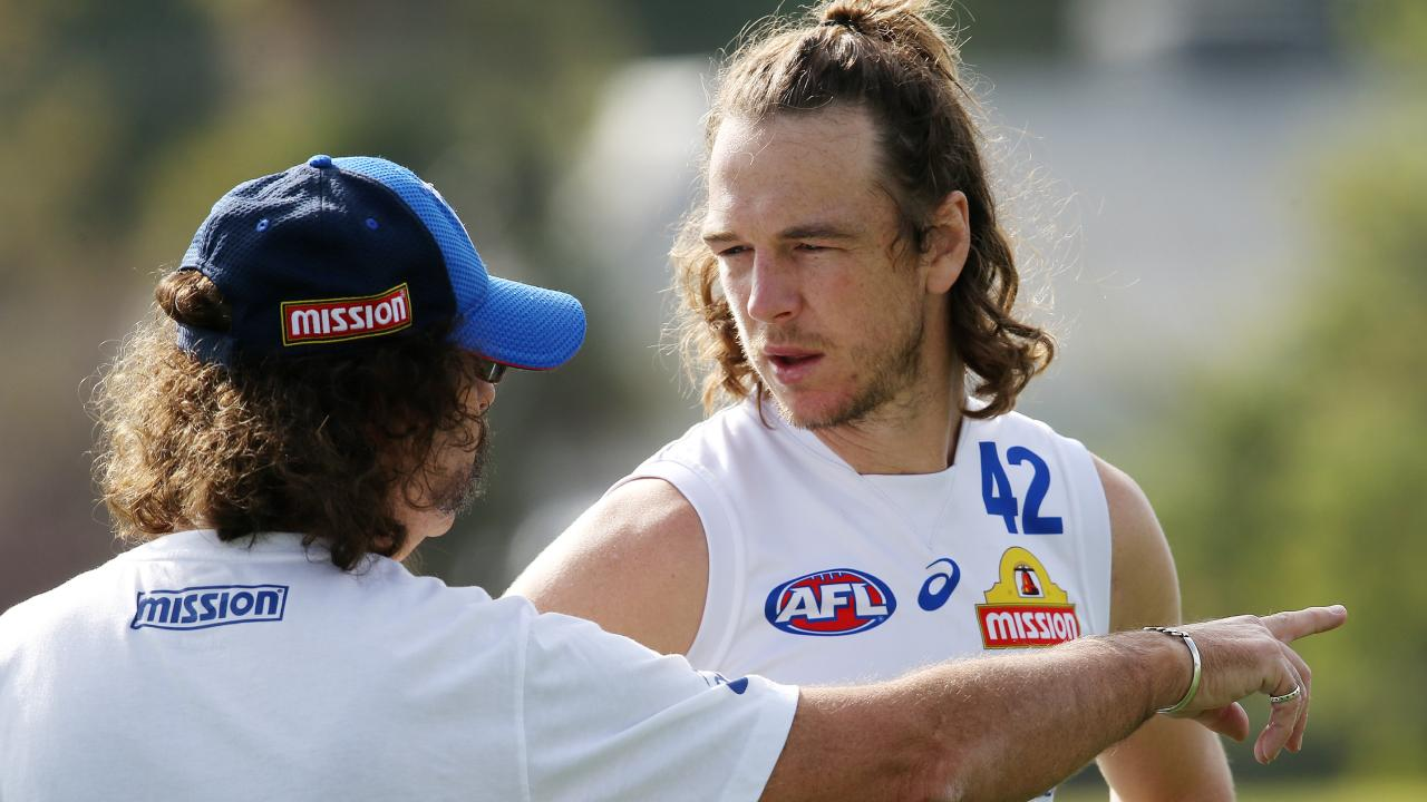 Liam Picken talks with club doctor Dr Gary Zimmerman at training last month. Pic: Michael Klein