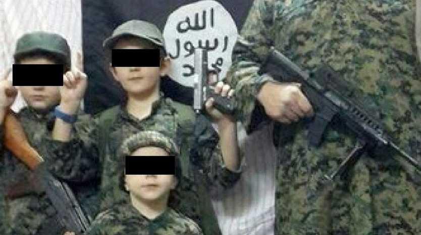 Khaled Sharrouf's children posing with their dad.