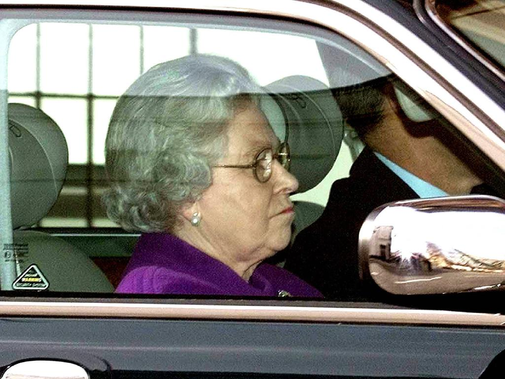 Queen Elizabeth II driving herself back to Windsor Castle after attending church in 2002. Picture: AP