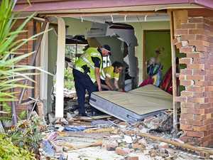 PHOTOS: Woman's lucky escape as car smashes through house