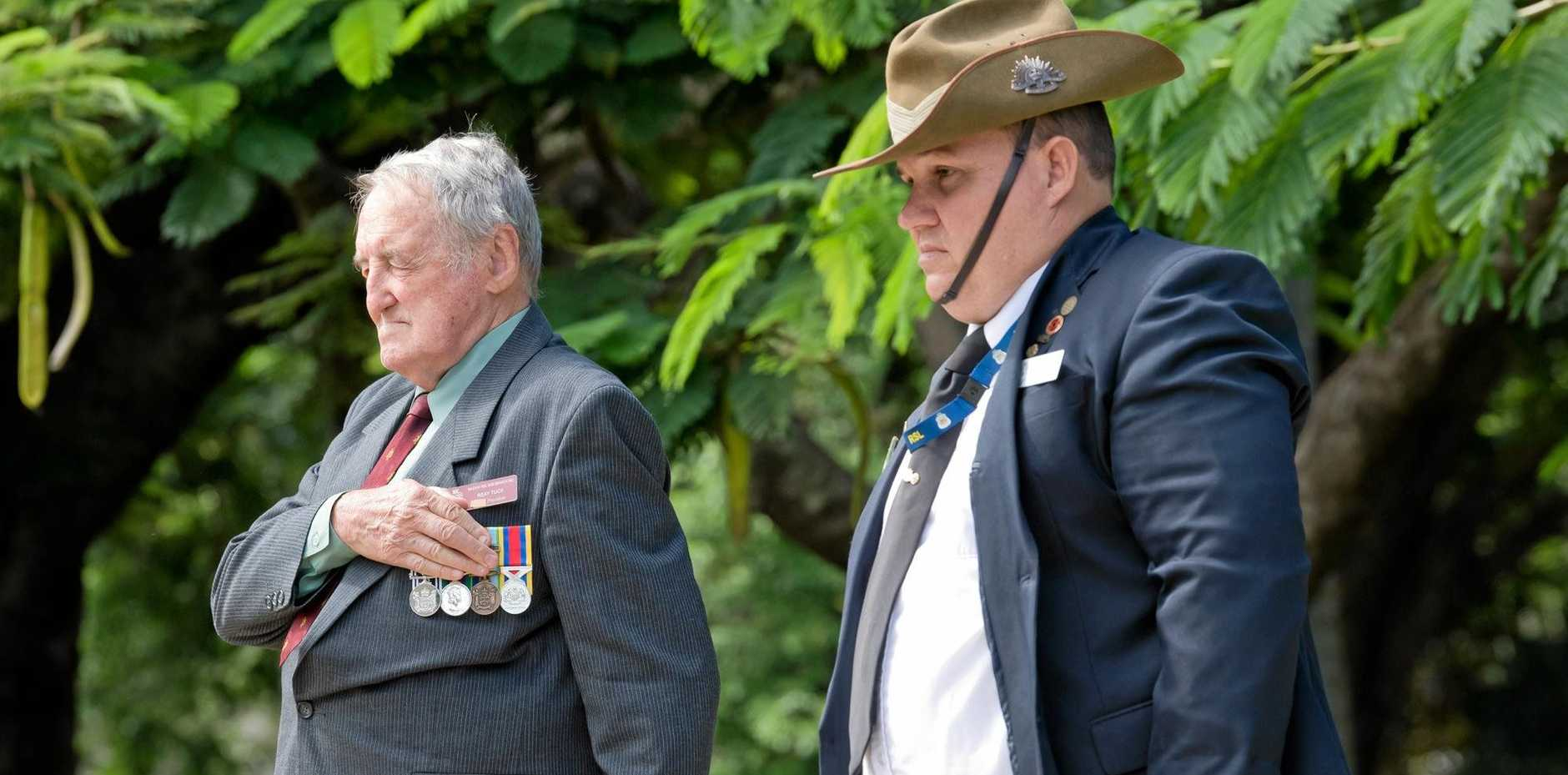 Mackay RSL sub-branch president Ray Tuck and junior military historian Graham Jackson after laying a wreath at the memorial.