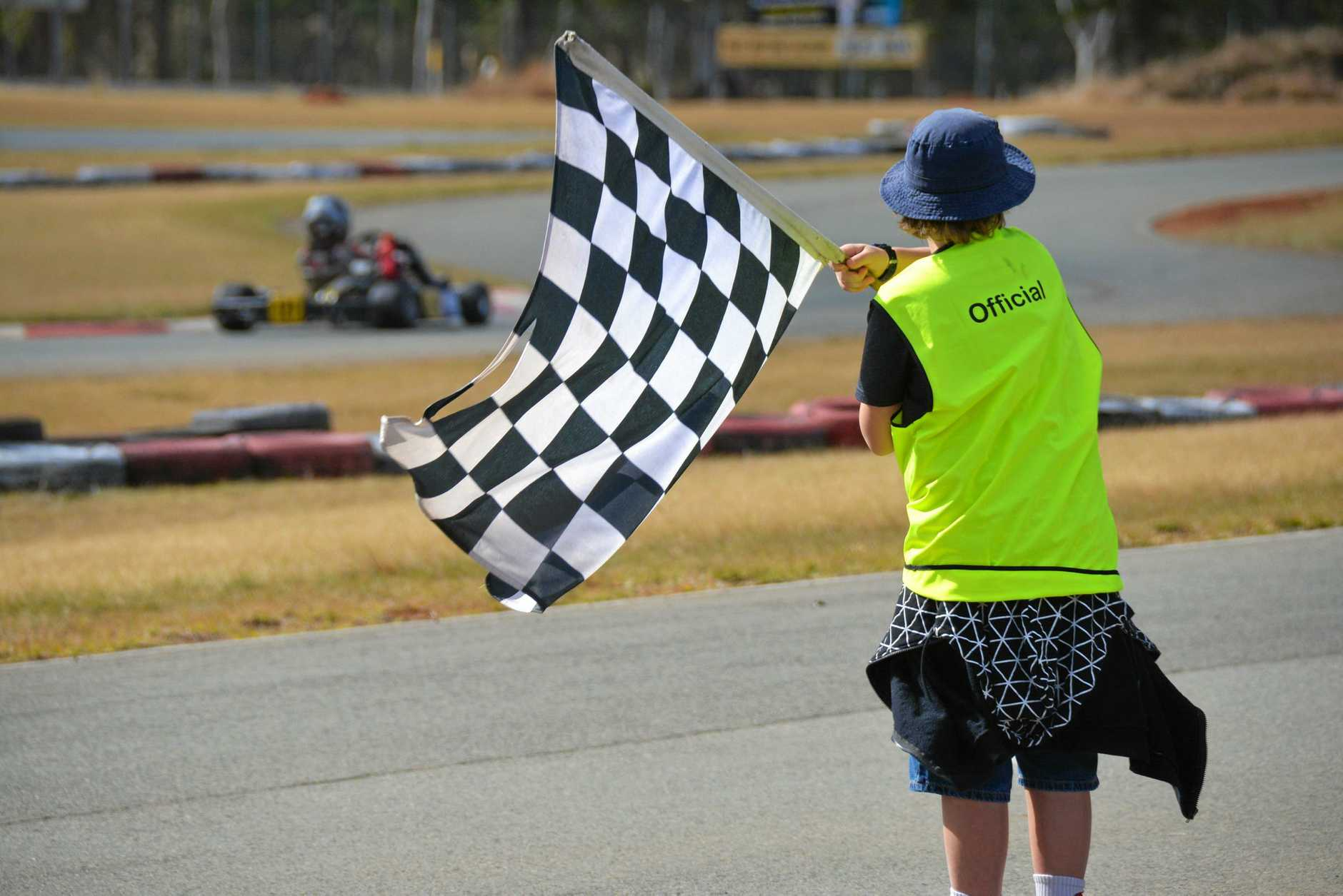 FINISH: A checked flag gives the drivers the signal the junior provisional race is finished during the AusKart competition at the South Burnett Kart Hire on Saturday August 14.