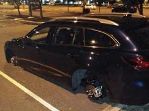 Wheels stripped from new car in shopping centre car park