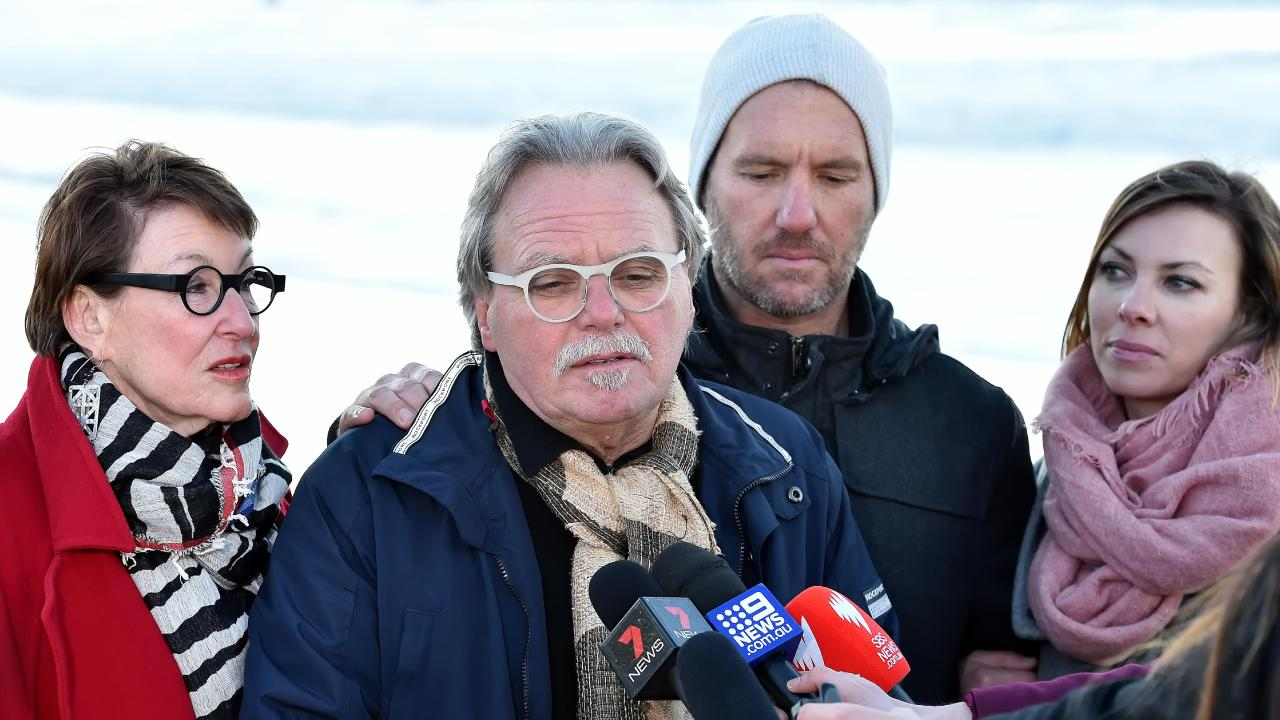 John Ruszczyk (father) speaks to media flanked by his wife (L) Maryan Heffernan (step-mother) and Jason Ruszczyk (brother) at a vigil for Justine Damond. Picture: AAP