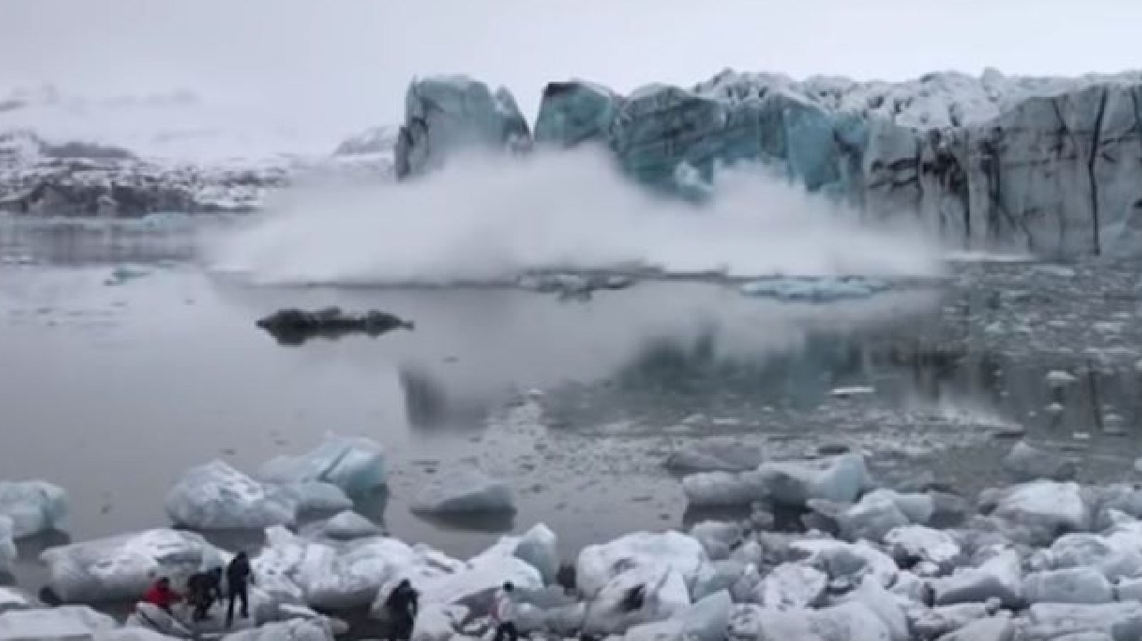 The video shows the glacier collapse causes a wave.