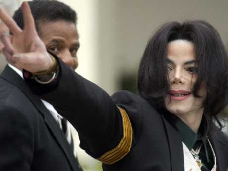 Jackson, who strongly denied the charges, flashes the peace sign to his fans at court. Picture: AP Photo/Michael A. Mariant, File