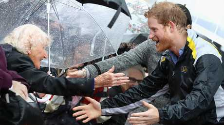 In 2017 Ms Dunne did mind the driving rain to see Prince Harry. Picture: Chris Jackson/Getty Images.