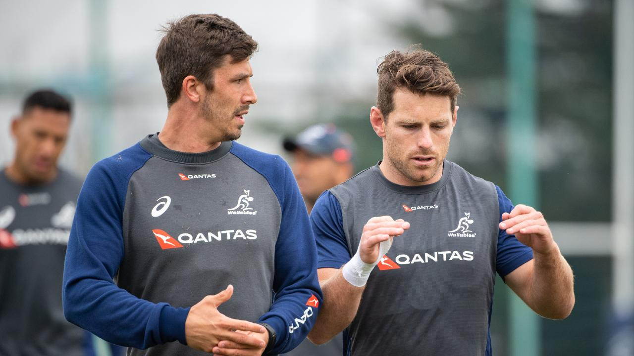 Jake Gordon and Bernard Foley talk tactics at Wallabies training. Photo: Stuart Walmsley/Rugby AU Media