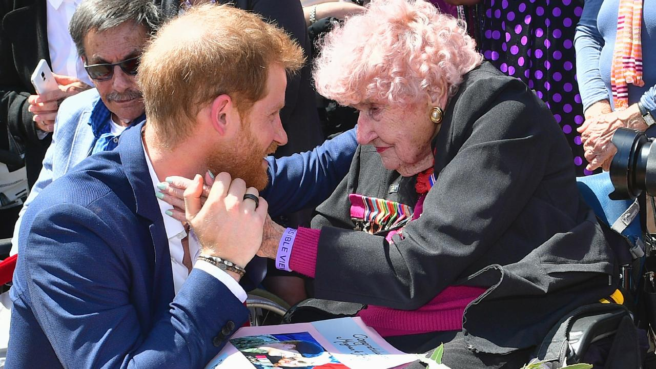 Prince Harry, Duke of Sussex greets royal fan and war widow Daphne Dunne at the Sydney Opera House. Picture: Samir Hussein/Samir Hussein / WireImage.