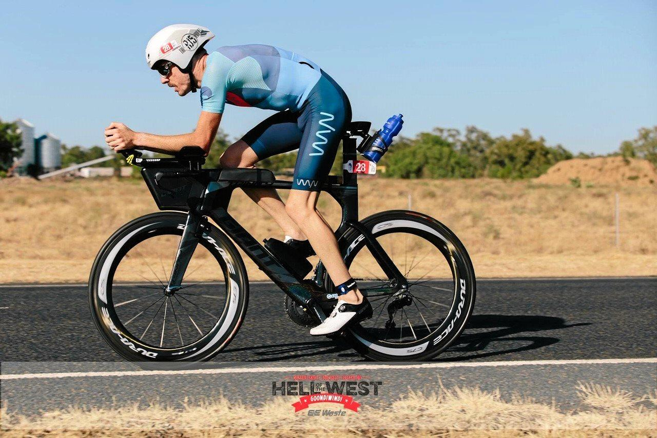 Rockhampton's Rhys Jones powers through the bike leg in the Hell of the West long course event in Goondiwindi.