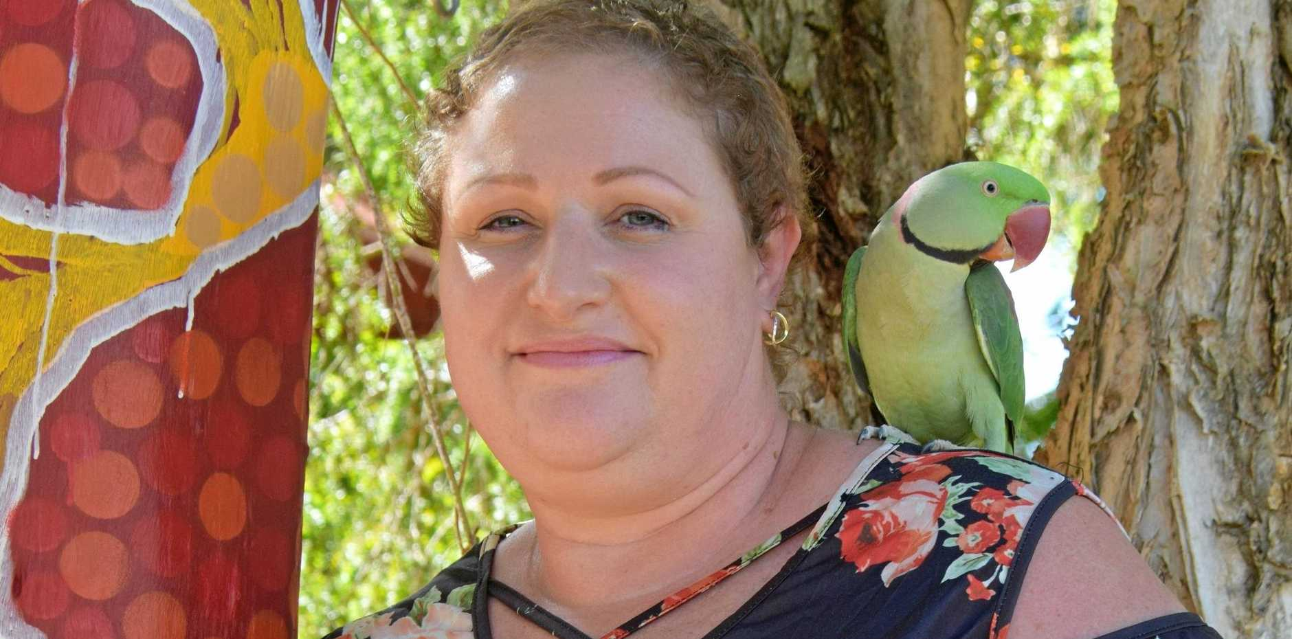 OUTSTANDING EMPLOYEE: Barb Corser with Pickles the parrot from St John's Kindy.