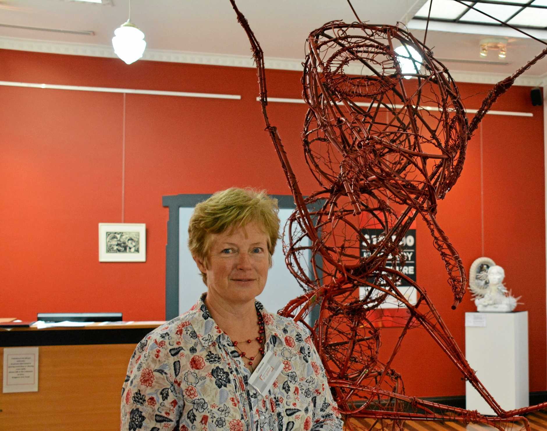 Kingaroy Regional Art Gallery art director Catherine Woodham with one of the sculpture entries.