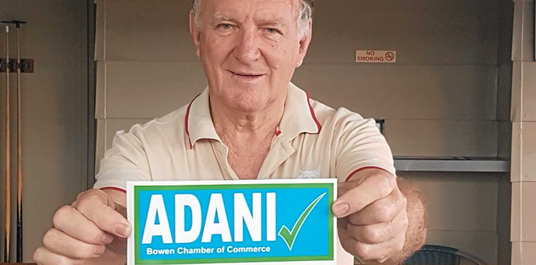 Bowen Chamber of Commerce chairman Bruce Hedditch and the new bumper sticker highlighting their support for Adani.