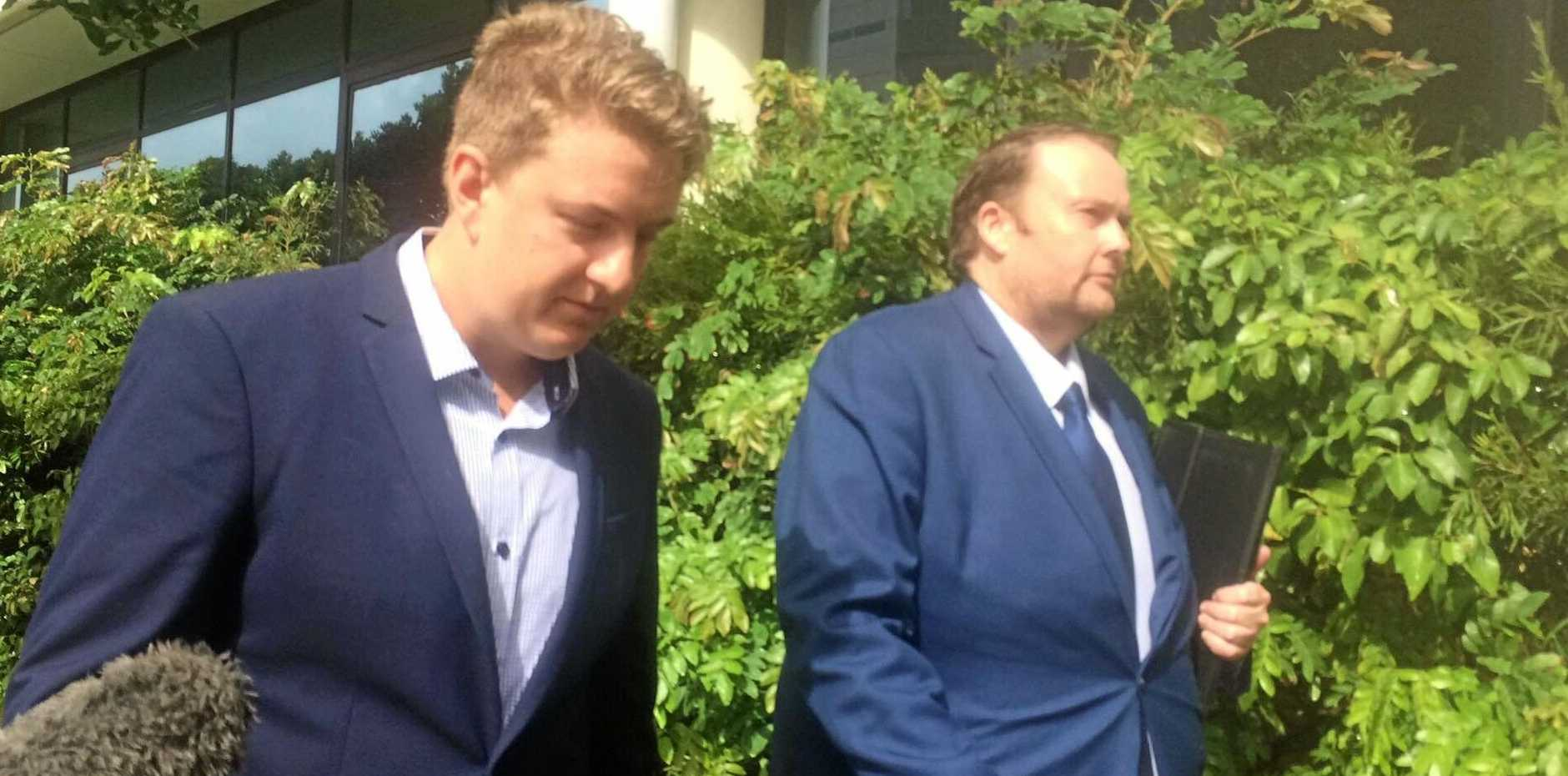 Kyle Jamie Stawski (left) has been charged with filming women in the changerooms at Rebel Sports, Maroochydore. Pictured leaving the Maroochydore Magistrates Court alongside his lawyer, Steven Brough (right).