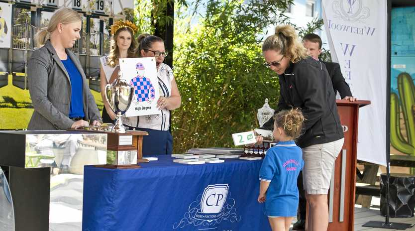 Trainer Rochelle Smith and daughter Willow Smith of Robchelle Racing draw barrier two for High Degree at yesterday's Toowoomba Cup public barrier draw at Walton Stores, Wednesday.