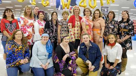 70s THEME: Big W Bundaberg employees celebrated 40 years of business at its Stockland premises on Wednesday. From back left: Ulla Bishop, Donna Jorgensen, Kym Richter, Kym Schmidt, Barb Minter, Lyn McGoldrick, Sue Pukallus, Andrea David, Jan Grills, Joanne Rumpf and Ruth Damiani. From front left: Christene Habermann, Kylie Cook, Alix Colman and Kyle Schneider.