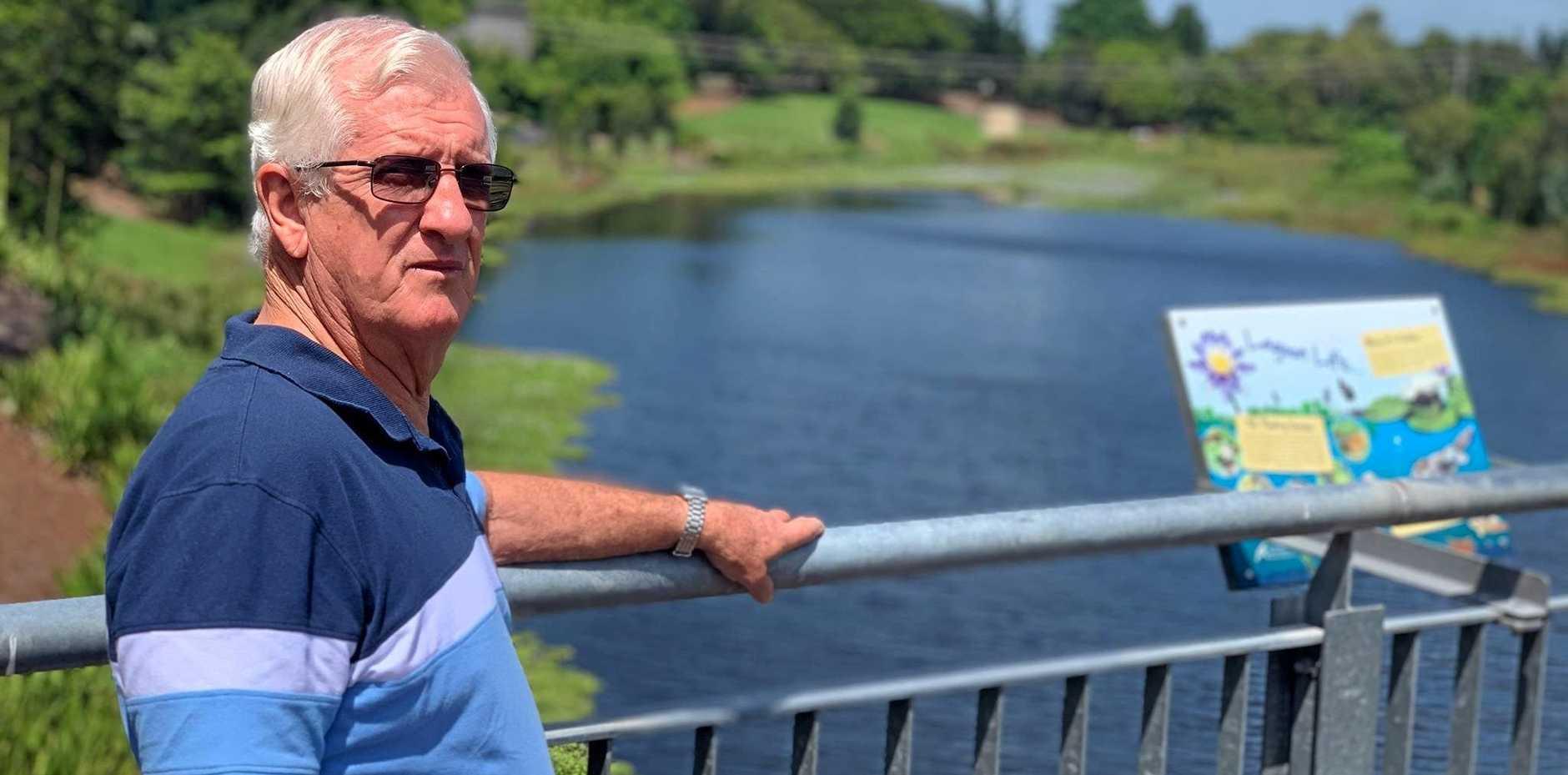 OVERGROWN: Mackay man Graeme Ransley is concerned about the pest weeds growing in the Mackay Botanic Gardens waterways.