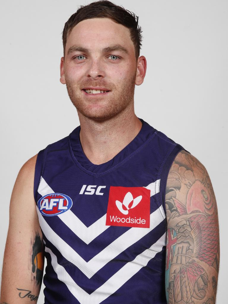 Not content with the dull blue, Wilson has (literally) injected some colour into his sleeve. Picture: AFL Media