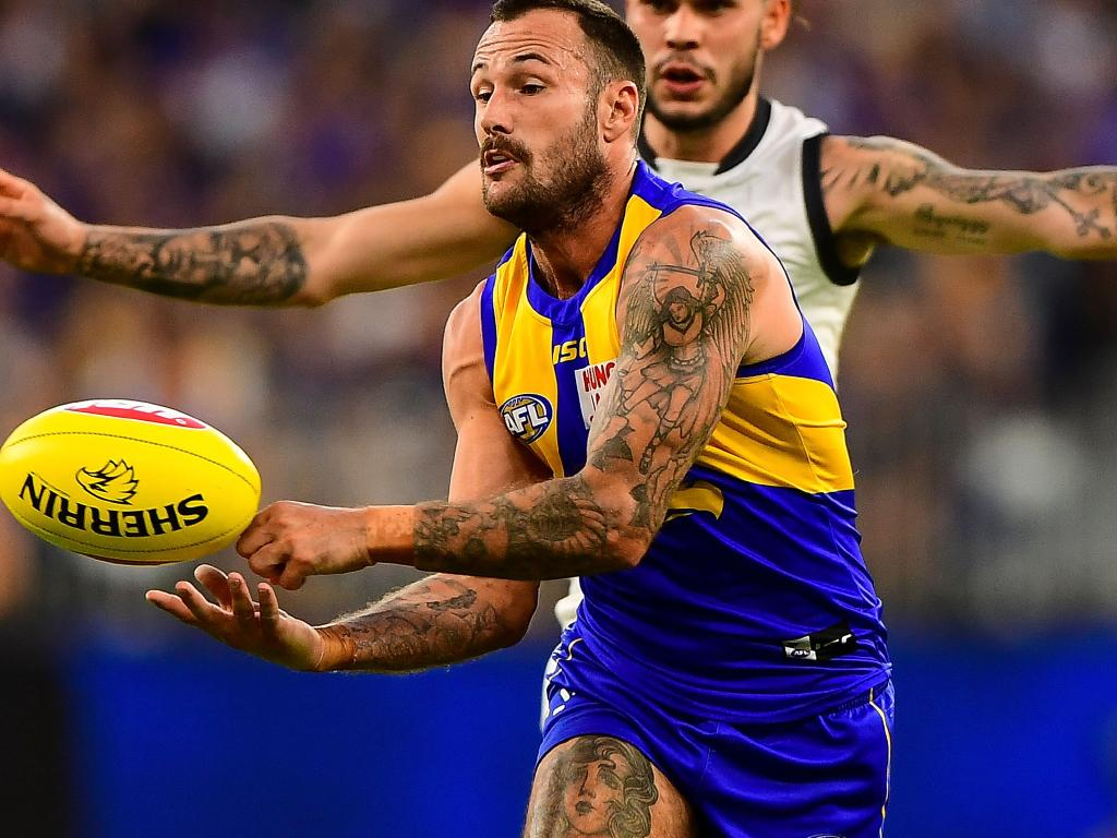 A heavily tattooed Chris Masten is pursued by a heavily tattooed Zac Williams. Picture: AFL Media