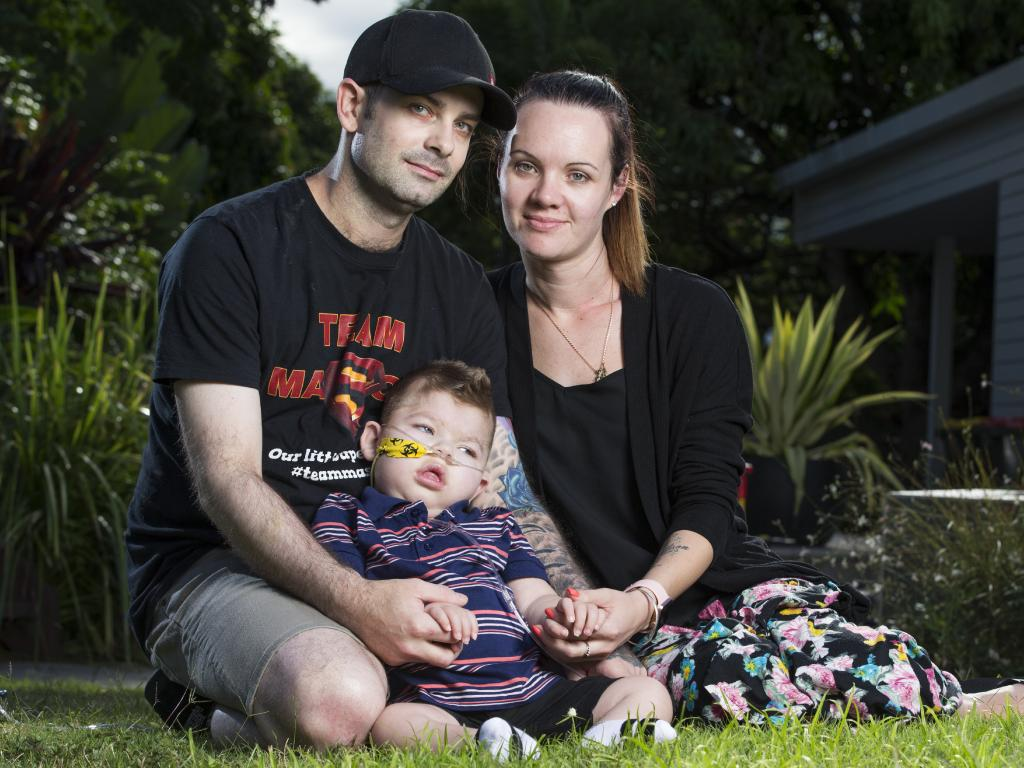 Adam Haevecker and Renee Bell with their 2 year old son Mason, who suffered brain damage after he went into cardiac arrest during heart surgery, is now in hospice care at Hummingbird House. Photo Lachie Millard