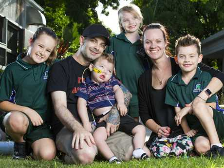 Adam Haevecker and Renee Bell with their 2 year old son Mason, who suffered brain damage after he went into cardiac arrest during heart surgery, and his siblings Paige, 9, Ava, 5, and Addison, 6 at Hummingbird House. Picture: Lachie Millard