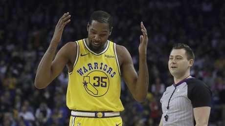 Kevin Durant throws his arms up in despair on his way to be ejected from the game. Picture: AP