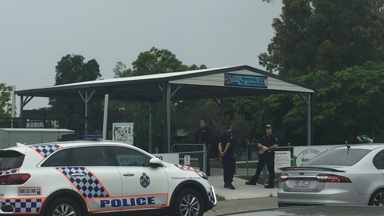 Police at Helensvale State School during a lockdown yesterday.