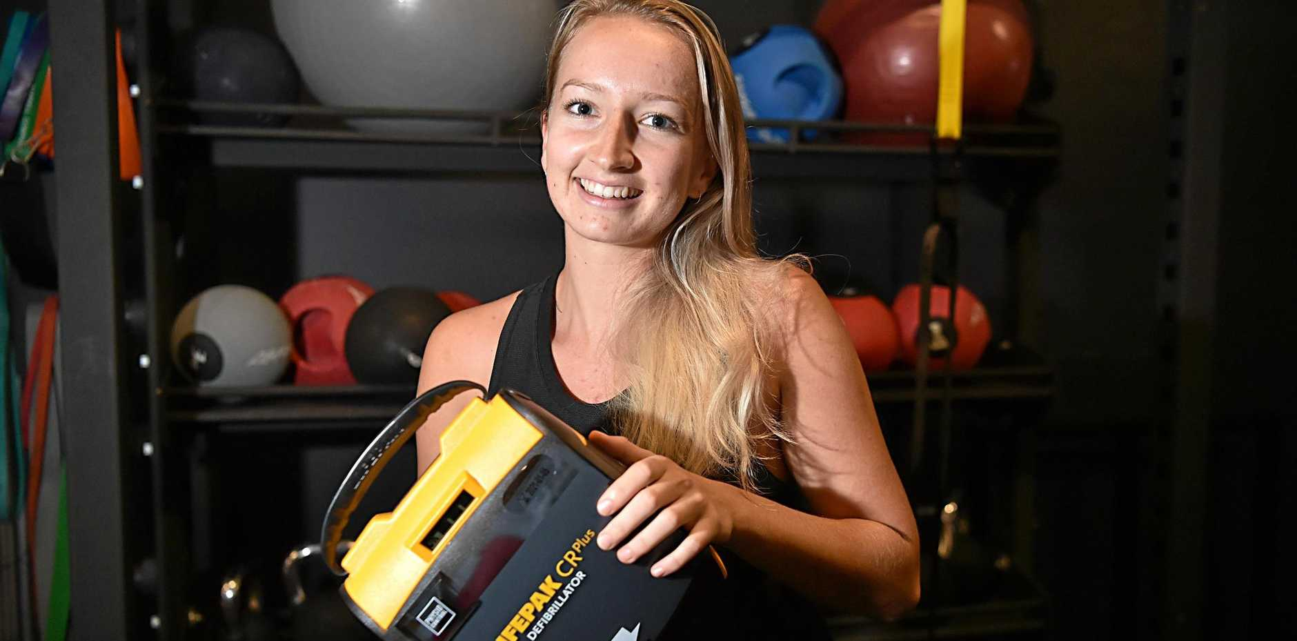 LIFE-SAVING DEVICE: Emily Counter with a defibrillator at Anytime Fitness, Kawana.