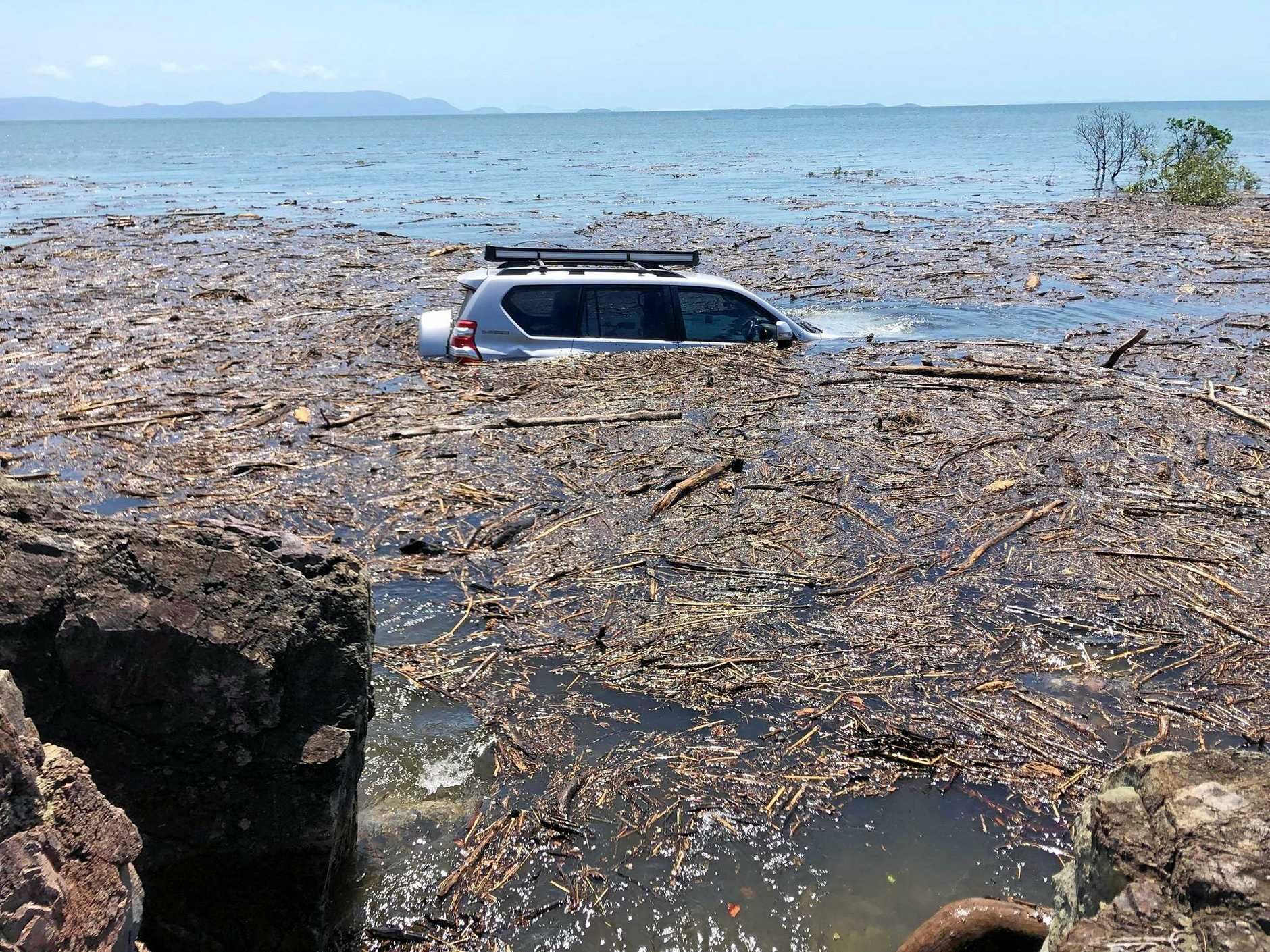 An unlucky boater has had his car swamped by the king tides at Midge Point after leaving it parked on an informal boat ramp known as Jimmy's Rocks.