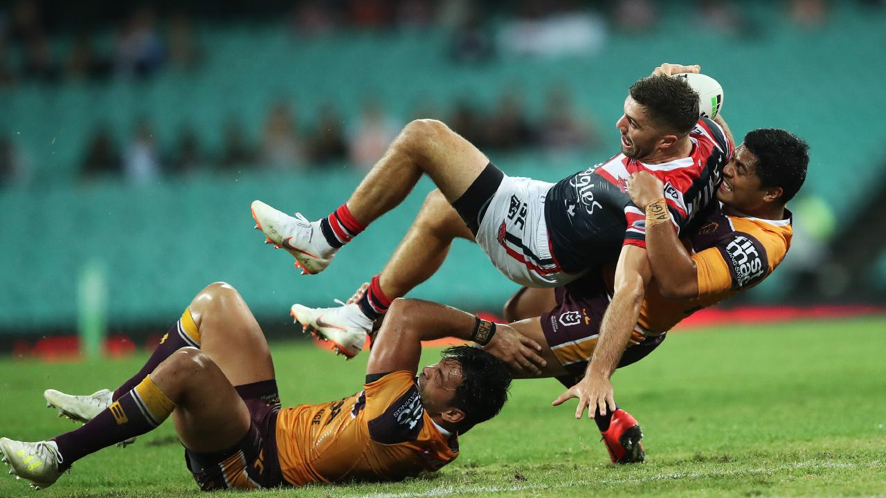 Anthony Milford makes a tackle on James Tedesco. Picture. Phil Hillyard